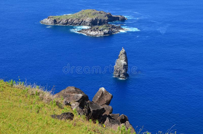 Motu Nui, Motu Iti and Motu Kau kau volcanic islets in Rapa Nui Easter island. Motu Nui, Motu Iti and Motu Kau kau islets are three islets at the westernmost tip stock image