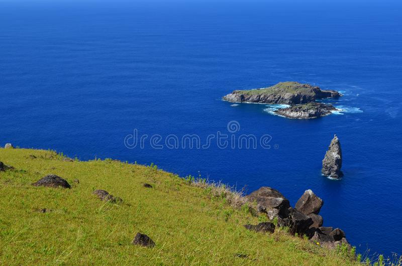 Motu Nui, Motu Iti and Motu Kau kau volcanic islets in Rapa Nui Easter island. Motu Nui, Motu Iti and Motu Kau kau islets are three islets at the westernmost tip royalty free stock photo