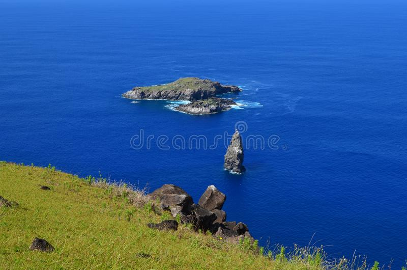 Motu Nui, Motu Iti and Motu Kau kau volcanic islets in Rapa Nui Easter island. Motu Nui, Motu Iti and Motu Kau kau islets are three islets at the westernmost tip stock photo
