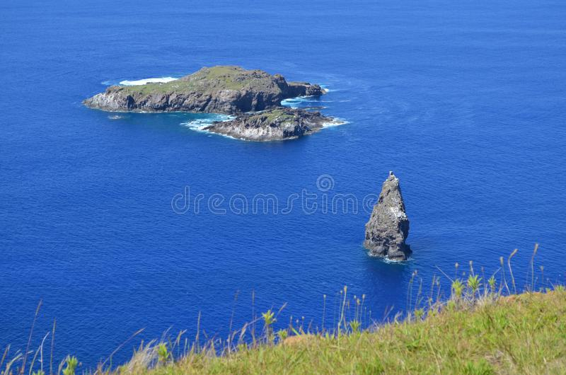 Motu Nui, Motu Iti and Motu Kau kau volcanic islets in Rapa Nui Easter island. Motu Nui, Motu Iti and Motu Kau kau islets are three islets at the westernmost tip royalty free stock photos
