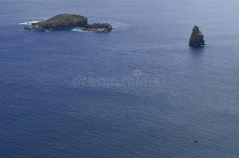 Motu Nui, Motu Iti and Motu Kau kau volcanic islets in Rapa Nui Easter island. Motu Nui, Motu Iti and Motu Kau kau islets are three islets at the westernmost tip royalty free stock images