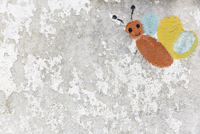 Motyl malujący dzieciakami na obieranie ścianie starzał się czasem obraz royalty free