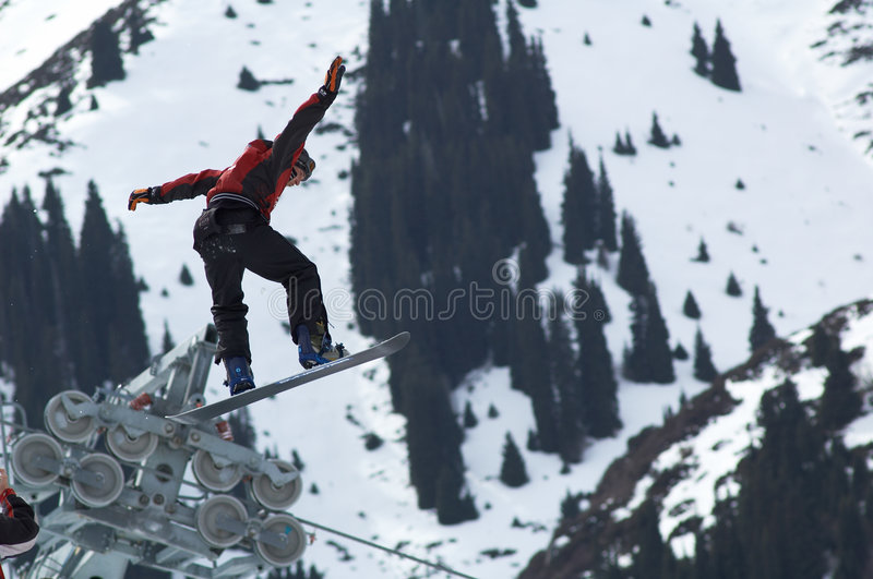 Mouche extrême de Snowboarder image libre de droits