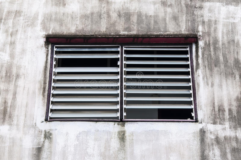 Moulder window. Louver with old building royalty free stock images