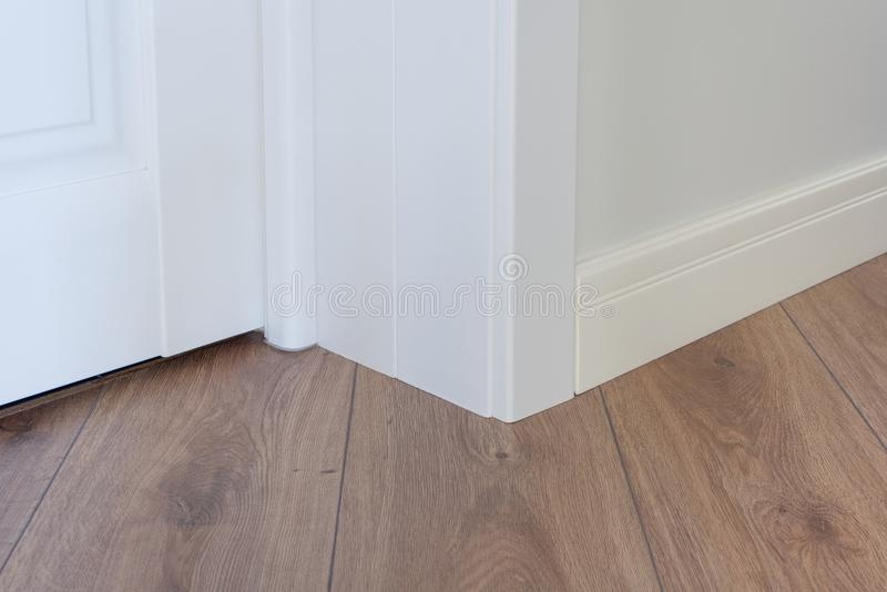 Moulding in the corner. Wall with laminate immitating oak texture. Moulding in the corner. Matte Wall with laminate immitating oak texture stock photo