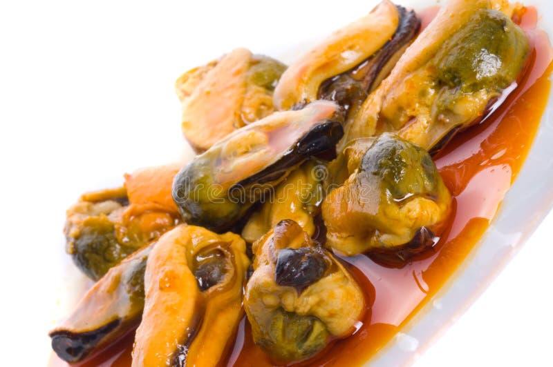 Moules en sauce rouge photo stock