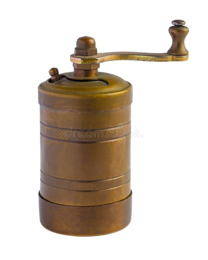 Moulin de poivre de cuivre de vintage d'isolement sur un blanc photo stock