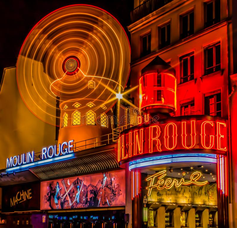 Paris, ÃŽle-de-France / France - May 3, 2011: A night long exposure view of the Moulin Rouge red mill stock photo