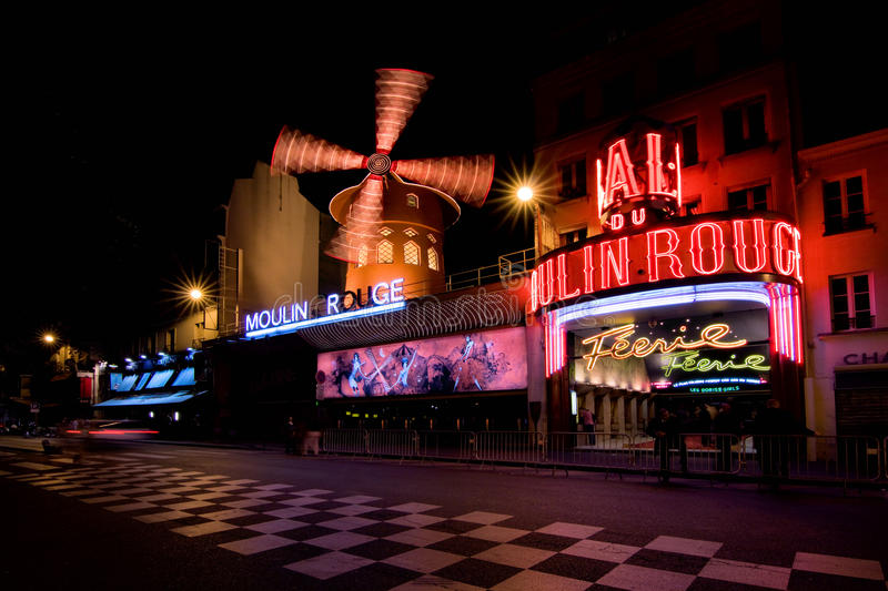 Moulin Rouge. Advertising cabaret show on facade of Moulin Rouge, famous cabaret and theater on September 3, 2012 in Paris, France royalty free stock image