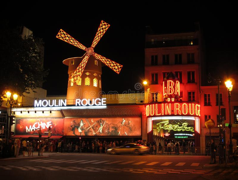Moulin Rouge Cabaret House in Paris, France at Night stock photos
