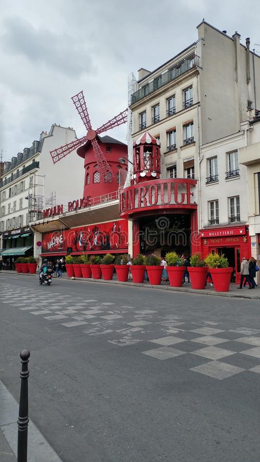 Moulin Rouge by day. In front of the beautiful Moulin Rouge stock image