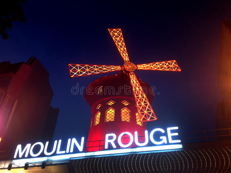 The Moulin Rouge. Moulin Rouge (French for Red Mill) is a cabaret in Paris, France. Close to Montmartre in the Paris district of Pigalle on Boulevard de Clichy stock photos