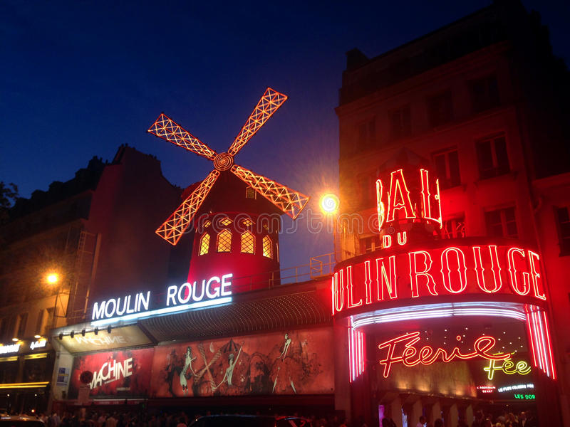 The Moulin Rouge. Moulin Rouge (French for Red Mill) is a cabaret in Paris, France. Close to Montmartre in the Paris district of Pigalle on Boulevard de Clichy stock photography
