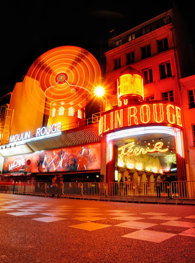 Moulin Rouge by Night. The famous Nightclub Moulin Rouge in Montmartre, Paris, by night stock image