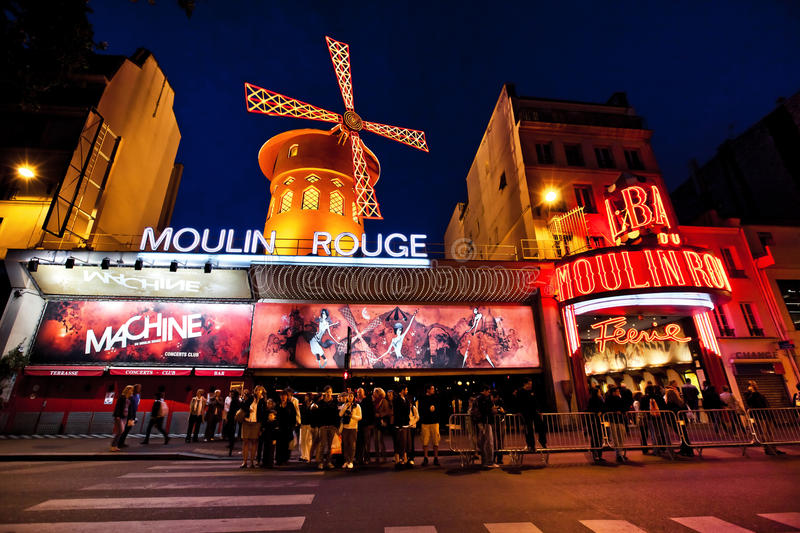 The Moulin Rouge by night in Paris, France royalty free stock image