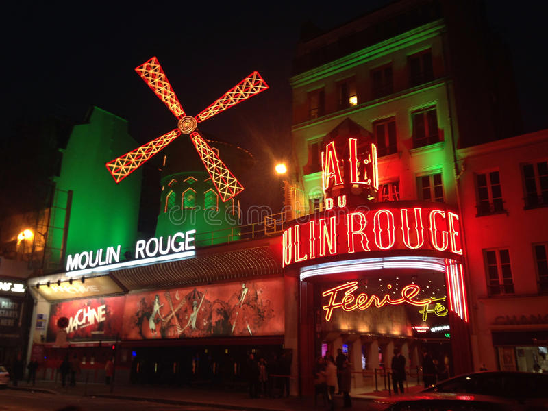 The Moulin Rouge- Paris. The Moulin Rouge is a cabaret in Paris, France. Close to Montmartre in the Paris district of Pigalle, it is marked by the red windmill royalty free stock photography