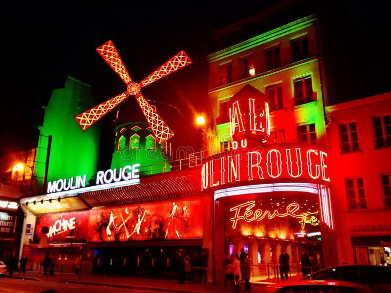 The Moulin Rouge- Paris. The Moulin Rouge is a cabaret in Paris, France. Close to Montmartre in the Paris district of Pigalle, it is marked by the red windmill royalty free stock photos