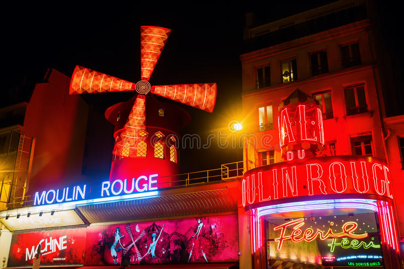 Moulin Rouge in Paris, France, at night royalty free stock images