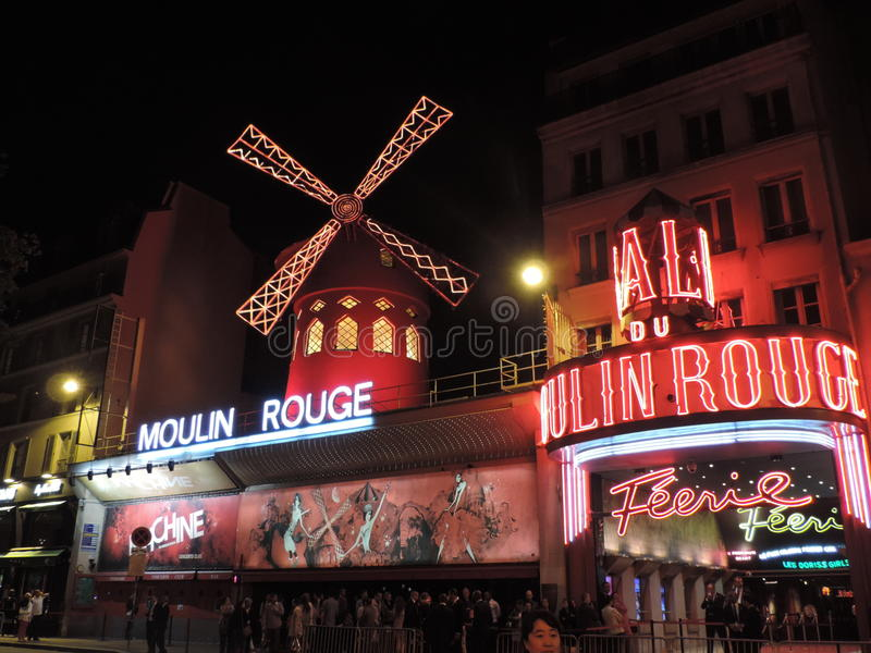 Moulin Rouge - Paris. The Moulin Rouge by night Moulin Rouge is a famous cabaret built in 1889, locating in the Paris red-light district of Pigalle stock images