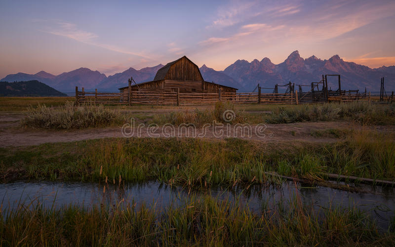 Moulton Barn creek at sunrise. Small creek in front of Moulton Barn on Mormon Row royalty free stock photo