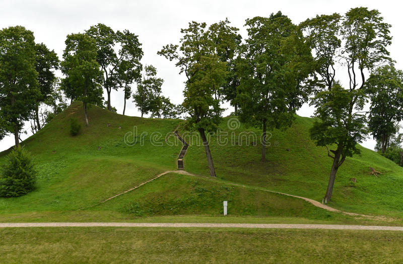 Mound in Ukmerge Lithuania. Castle mound in Ukmerge, landscape view. Ukmerge district is a region of Lithuania that is rich in its historical past stock photos