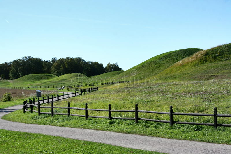 Mounds and the fence royalty free stock photo