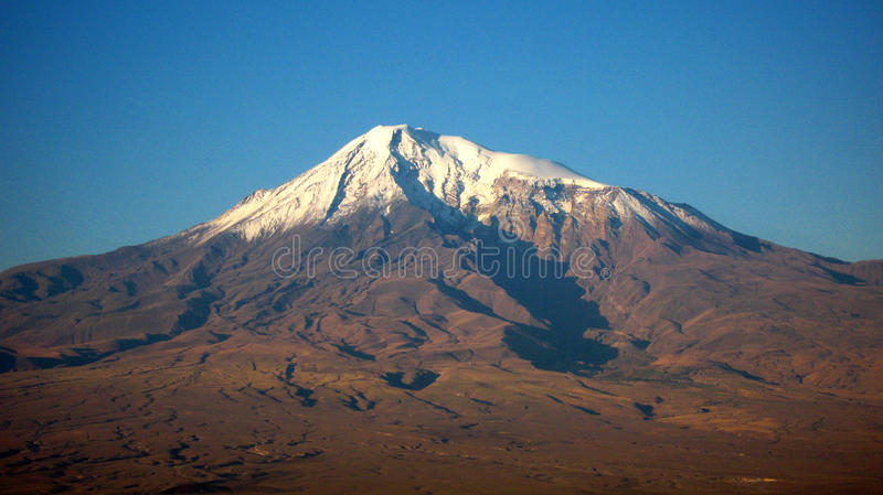 Mount Ararat in Armenia and Turkey in autumn. Mount Ararat in Armenia and Turkey Red autumn landscape below. snow cap on the mountain top of the volcano royalty free stock images