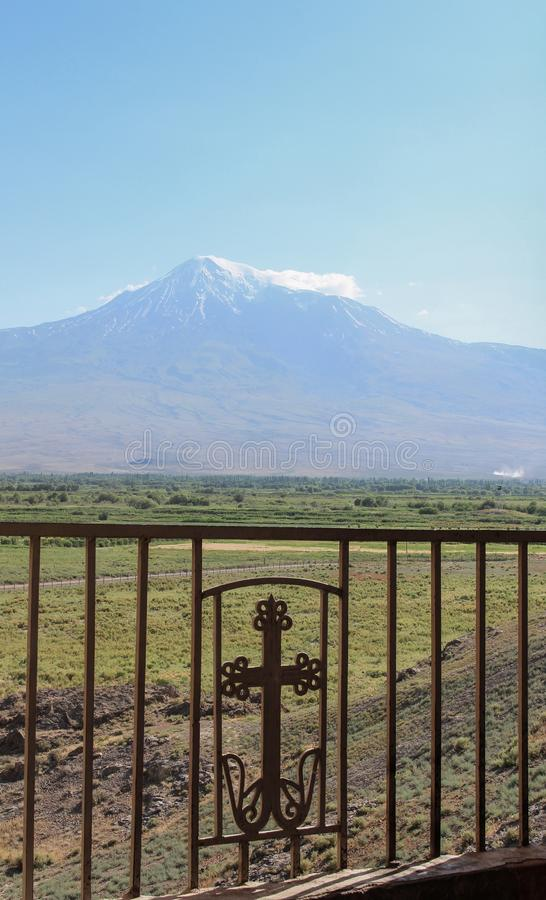 Mount Ararat from distance with green fields and armenian cross royalty free stock photo