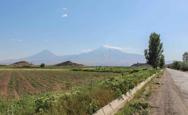 Mount Ararat from distance with green fields royalty free stock image