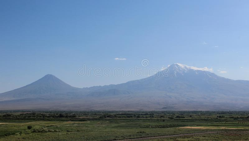 Mount Ararat from distance with green fields stock photography