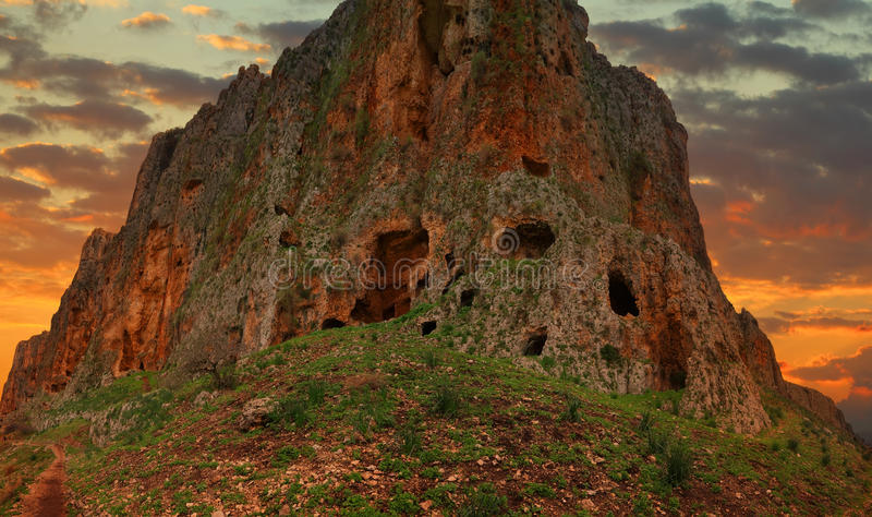 Mount Arbel at sunset. Arbel Cliff. Cave Fortress. Low Galilee, Israel. Panoramic view royalty free stock photo