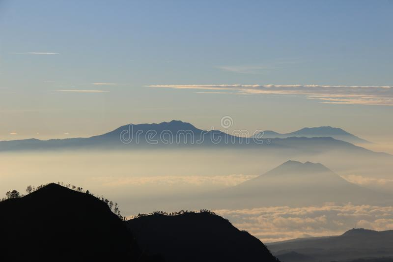 Mount Argopuro is visible from the top of distant Mount Bromo. Enjoy the morning at the height of Mount Bromo National Park and photograph Mount Argopuro which stock photo
