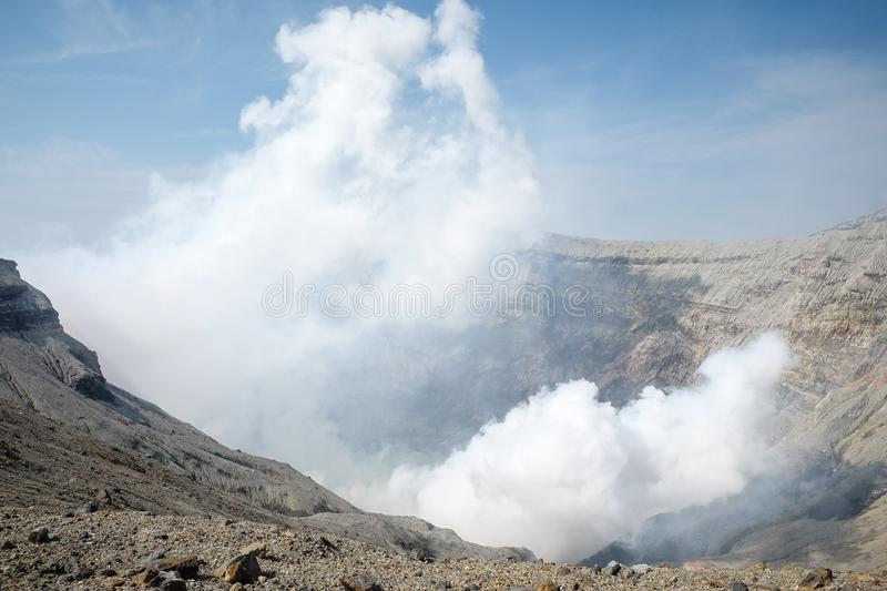 Mount Aso, Beautiful Panorama Aerial View. Smoke Gas Steam Crater Caldera largest active Volcano in Japan Island eruption under Sunny Clear Blue Sky in Summer stock images
