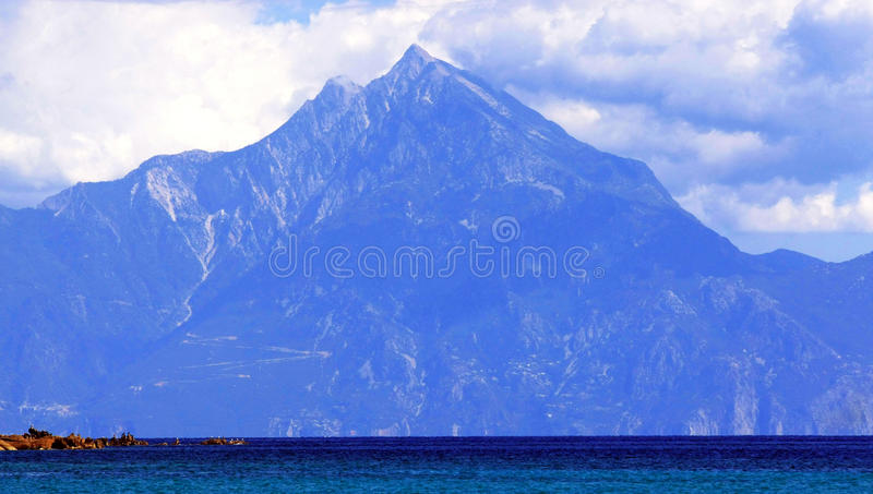 Mount Athos. A view of Mount Athos, Macedonia, Greece. The mountain is bathed in blue royalty free stock photos