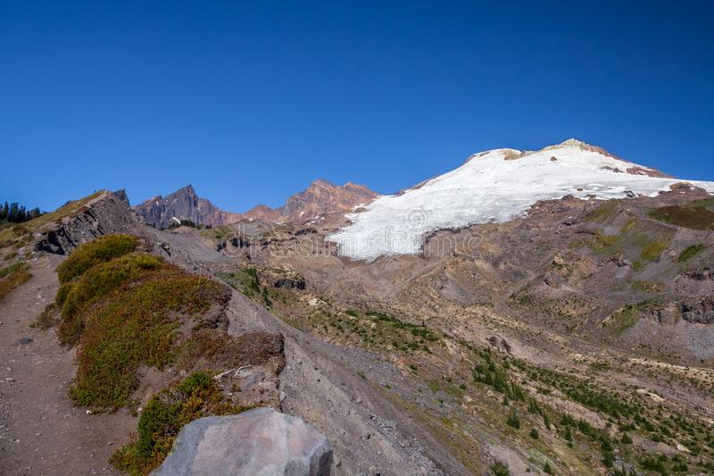 Mount Baker and Easton Glacier from Railroad Grade trail. In late summer, it`s possible to hike close to the glaciers on the southern flank of Mount Baker. This royalty free stock images