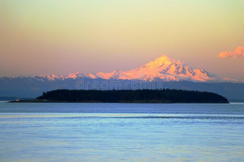 Mount Baker in Evening Light from East Point on Saturna Island, British Columbia. Last evening sunshine illuminates the snow-covered strato volcano Mount Baker stock photo