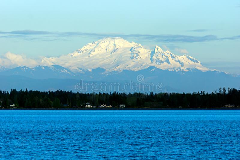 Mount Baker. An active glaciated andesitic stratovolcano in the Cascade Volcanic Arc and the North Cascades of Washington, viewed from Semiahmoo Park near royalty free stock image