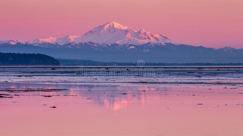 Mount Baker reflection. Reflection of mount baker with the last of the sunlight on its snowy peak stock photography