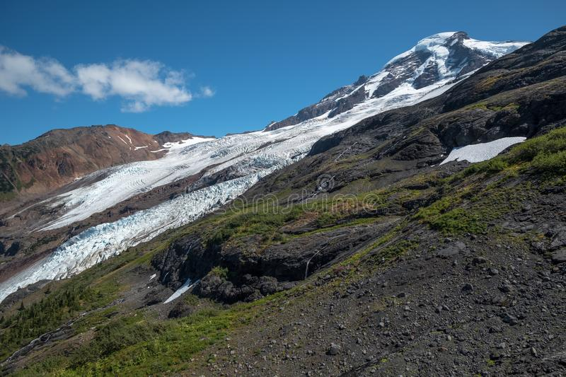 Mount Baker`s awesome west face with magnificent glaciers. Wash. At the end of August, all of winter`s snow has melted on Washington State`s Mount Baker leaving royalty free stock image