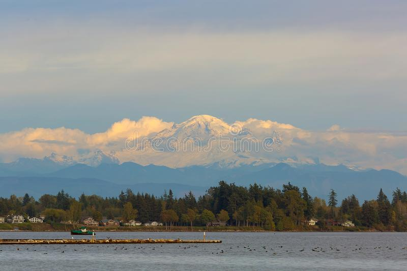 Mount Baker from Semiahmoo Bay in Washington state USA. Mount Baker along Semiahmoo Bay waterfront homes in Blaine Washington State United States America stock images