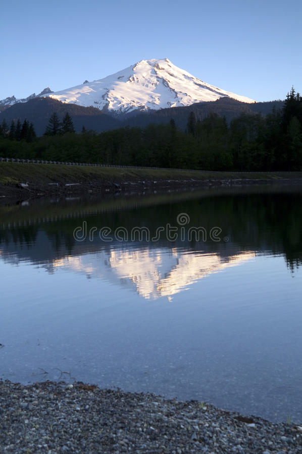 Mount Baker-Snoqualmie National Forest Baker Lakes Reflection. Mount Baker is reflected in the lake of the same name stock photo