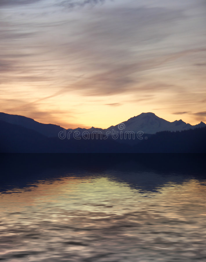 Mount Baker Sunrise. A mount baker sunrise above its reflection in water stock photos