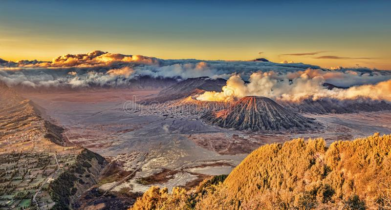 Mount Bromo landscape view in high resolution image with cloudy sunset morning. Mount Bromo panorama high resolution photo in sunrise with volcanic smoke motion stock image