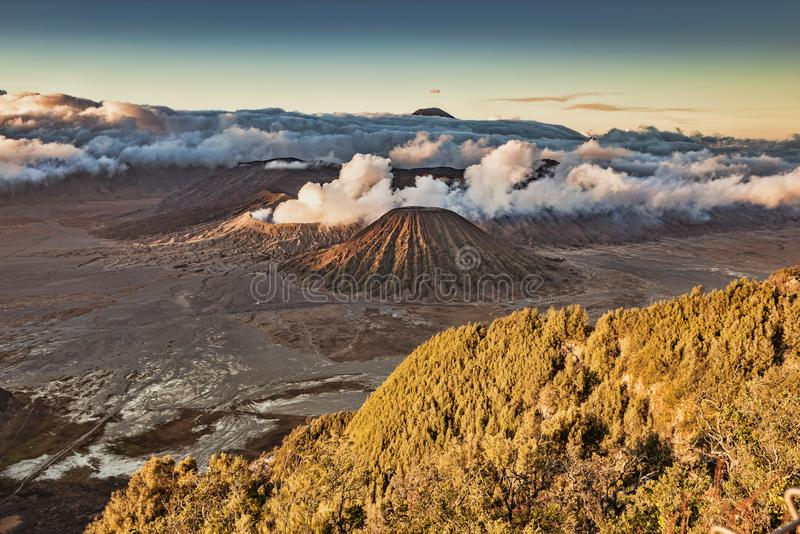 Mount Bromo landscape view in high resolution image, shot from Pananjakan point. Mount Bromo panorama high resolution photo in sunrise with volcanic smoke motion royalty free stock photo