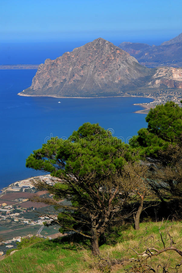 Mount Cofano and Mediteranean Sea, Sicily. Elevated view of Cofano taken from the medieval village of Erice. Between Erice and Cofano, is the Gulf of Bonagio stock images