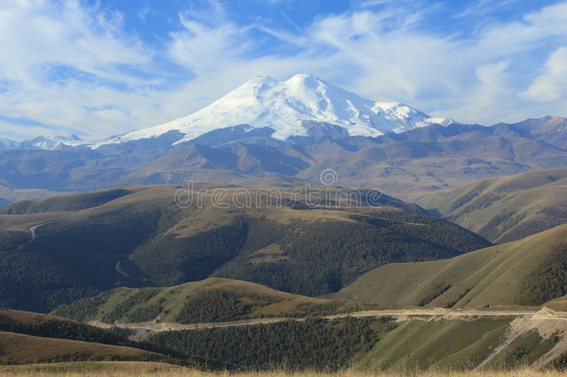 Mount Elbrus. North Caucasus. In the photo Mount Elbrus, the highest mountain of the North Caucasus is represented. The photo was made at sunrise. There is an royalty free stock image