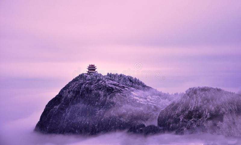 Mount Emei`s spiritual path is long and far, cloud mountain fog cover in the golden temple shining golden light stock images