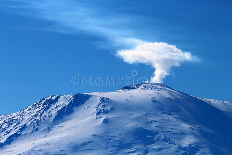 Mount Erebus, Antarctica. Plume rising from the crater of Mount Erebus seen from Scott Base. Located near the United States base at McMurdo, this is the most