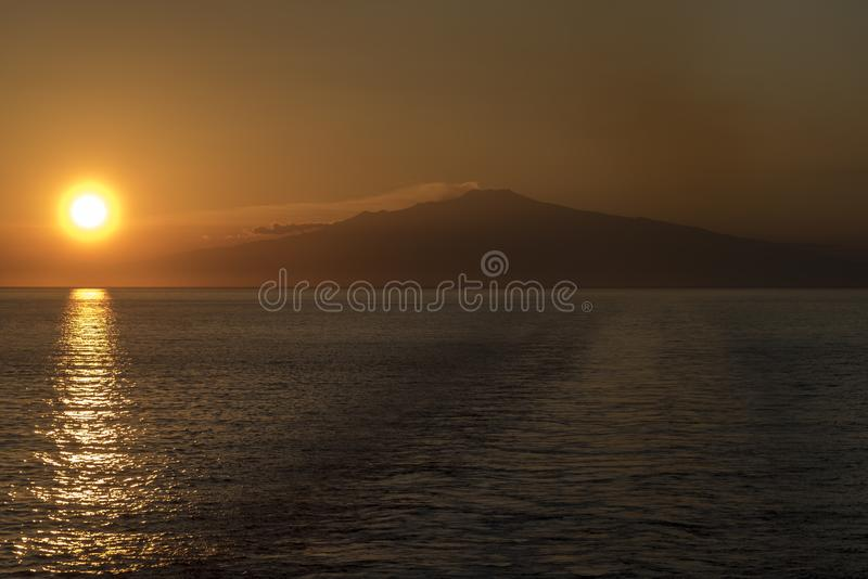 Mount Etna Sunset Sicily. Mount Etna Sunset Mount Etna is an active stratovolcano on the east coast of Sicily, Italy, in the Metropolitan City of Catania stock photography