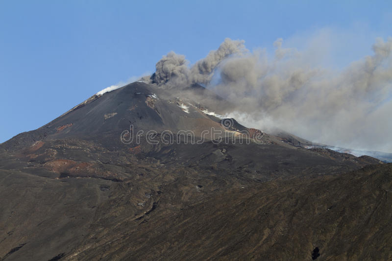 Mount Etna activity. Volcanic eruption of Mount Etna. emission of volcanic ash from the new South East Crater stock photography
